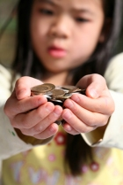 child giving money